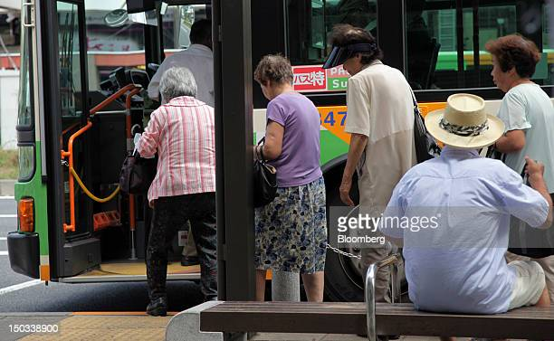 Passengers board a bus at a bus stop in Tokyo Japan on Thursday Aug 16 2012 With 7 million baby boomers starting to retire this year and about...