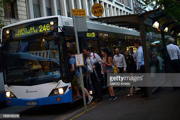 Passengers board a bus in Sydney on March 12 2013 A key poll shows Australian Prime Minister Julia Gillard's personal rating has risen but her Labor...