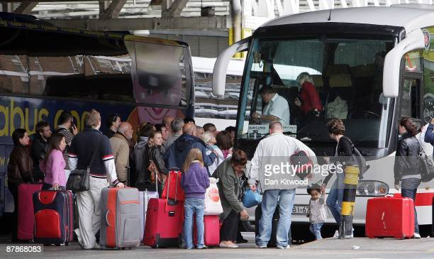 Passengers board a bus leaving for Poland from Victoria coach station on May 20 2009 in London England The Office for National Statistics has...