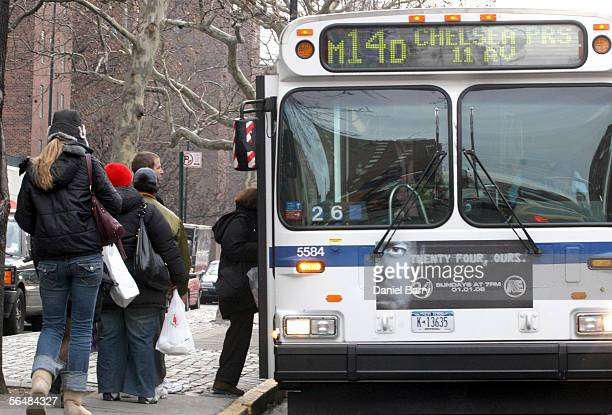Passengers board a bus near First Avenue December 23 2005 in New York City After three days of strikes New York City subways and buses returned to...
