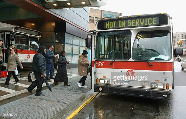 Passengers board a bus operated by Triboro Coach Corp displaying 'out of service' at a bus depot in Jackson Heights New York Friday December 16 2005...