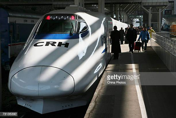 Passengers board a CRH 'bullet train' at Nanjing Railway Station on January 28 in Nanjing of Jiangsu Province China China's 'bullet train' the...