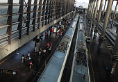 Passengers board a high speed Ave train at Atocha station a day after Greeks voted in a referendum to reject the European Union's latest Bailout...
