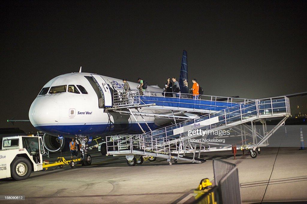 BEACH, CA - DECEMBER 6 Passengers board a Jet Blue Airways flight December 6, 2012 in Long Beach, California.