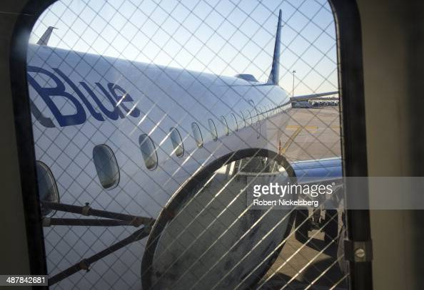 Passengers board a JetBlue Airways plane April 1 2014 at John F Kennedy International Airport in Queens New York