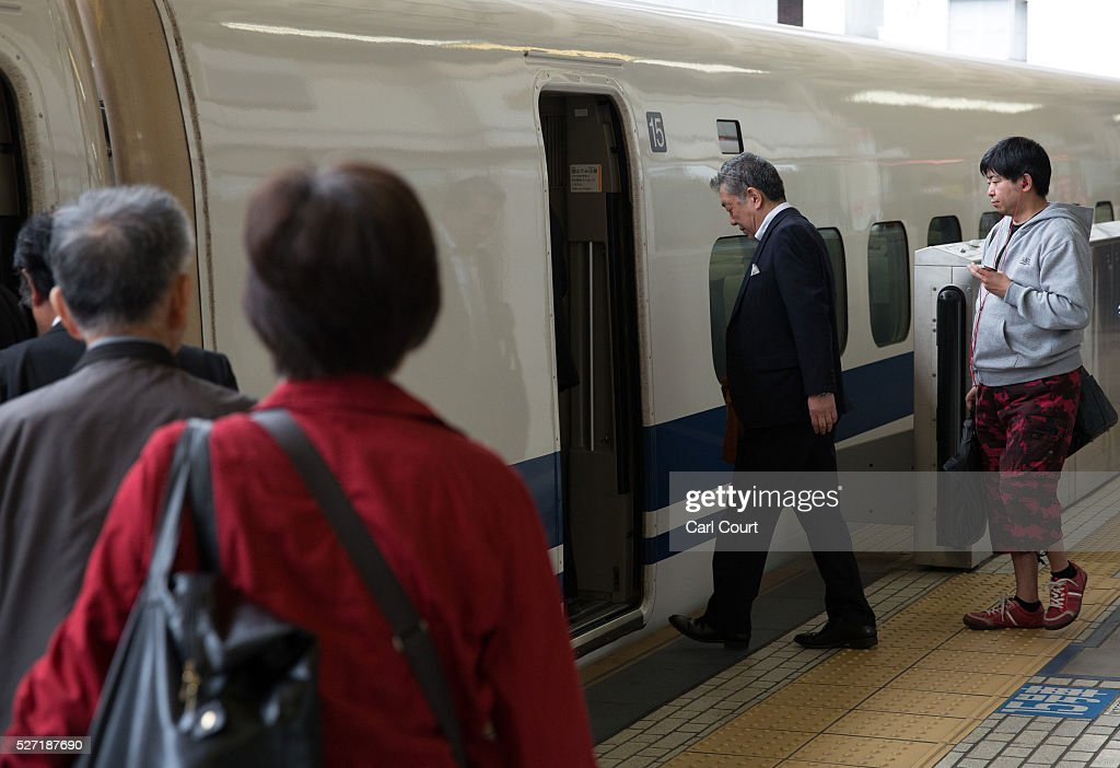 Passengers board a Shinkansen bullet train at Tokyo Train Station on May 02, 2016 in Tokyo, Japan. The Shinkansen is a network of high-speed railway lines in Japan currently consisting of 2,764.6 km (1,717.8 mi) of lines with maximum speeds of 240-320 km/h (150-200 mph). The network presently links most major cities on the islands of Honshu and Kyushu, and Hakodate on northern island of Hokkaido. The maximum operating speed is 320 km/h (200 mph) though test runs have reached up to a world record 603 km/h (375 mph) for maglev trains in April 2015.