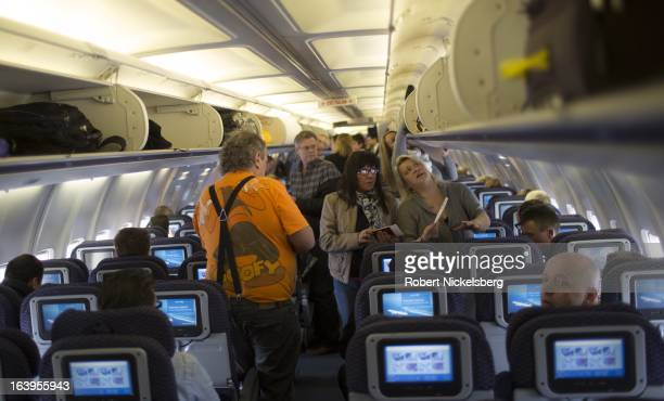 Passengers board a United Airlines plane to New York at the Oslo Airport Gardermoen March 9 2013 in Oslo Norway Gardermoen is the main domestic hub...
