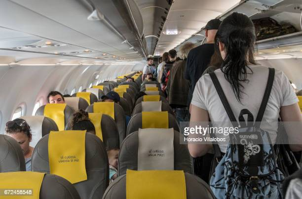 Passengers board a Vueling airplane in Terminal 1 of Humberto Delgado Airport on April 19 2017 in Lisbon Portugal The airport is the main...