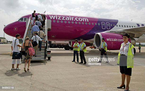 Passengers board a Wizz Air airplane on the tarmac at Gerona International Airport in Gerona Spain Friday September 2004 Wizz Air whose fares are...