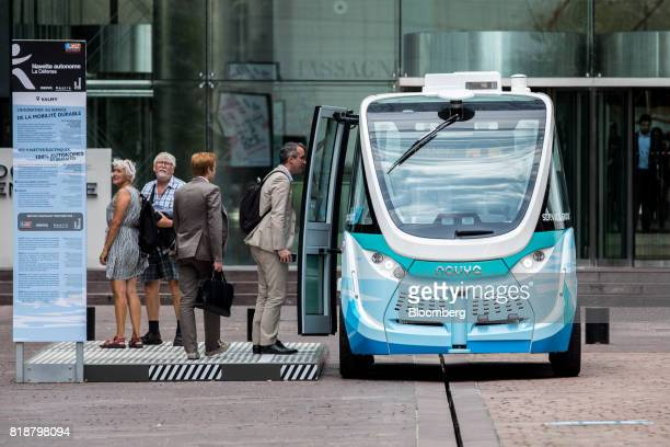 Passengers board an Arma autonomous shuttle bus manufactured by Navya Technologies SAS in La Defense business district of Paris France on Wednesday...
