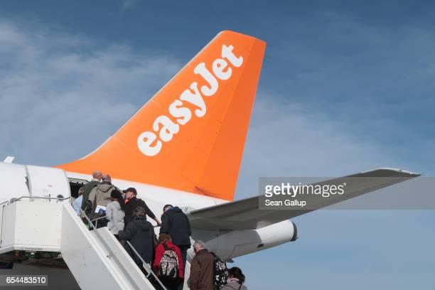 Passengers board an easyJet flight at Schoenefeld Airport near Berlin on March 4 2017 in Schoenefled Germany EasyJet is among Europe's leading...