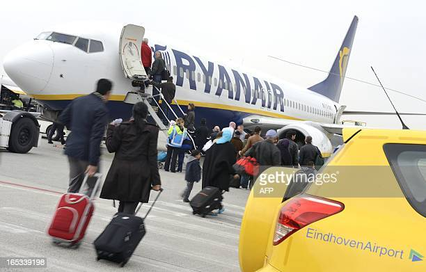 Passengers board into a Ryanair airline Irish company's aircraft at the Eindhoven Airport a new base for the company on April 3 2013 AFP PHOTO/ ANP /...