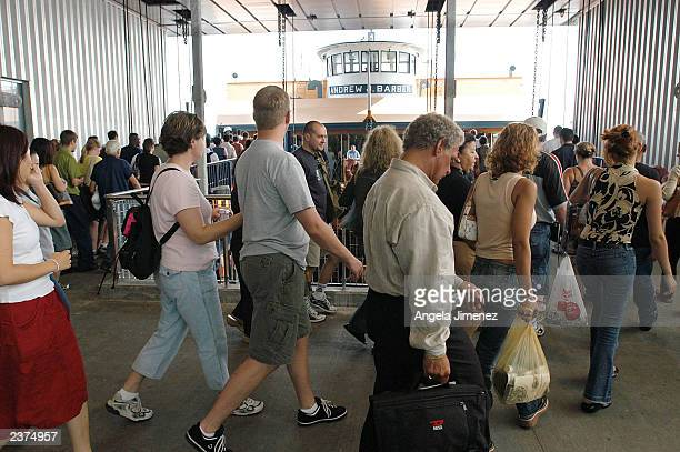 Passengers board the Staten Island Ferry at the Whitehall Terminal at Whitehall and South Streets August 6 2003 in New York City The Coast Guard has...