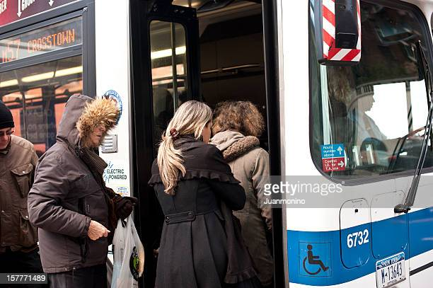 Passengers Boarding a City Bus