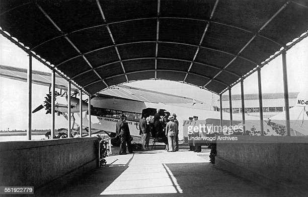 Passengers boarding a Pan American Airways Ford Trimotor plane for a trip to Havana Cuba Miami Florida 1927 It was a palatial liner that also served...
