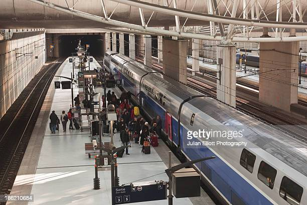 Passengers boarding a TGV at Charles De Gaulle.