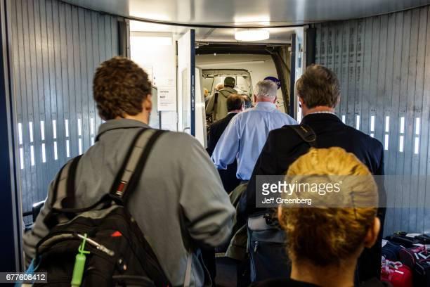 Passengers boarding a US Airways flight at John F Kennedy International Airport