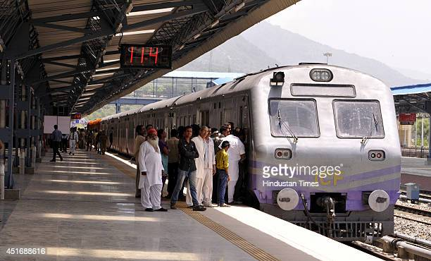 Passengers boarding train at Katra Railway station after the inauguration of the KatraUdhampur rail link on July 4 2014 in Jammu India Prime Minister...
