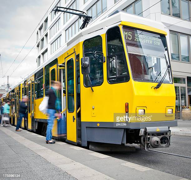 passengers boarding tram in Berlin germany