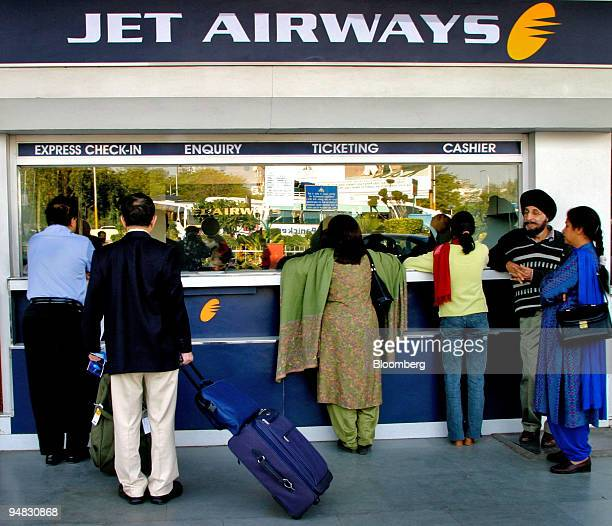 Passengers buy tickets from a Jet Airways counter at Indira Gandhi International Airport in New Delhi India Saturday February 19 2005 Jet Airways Ltd...