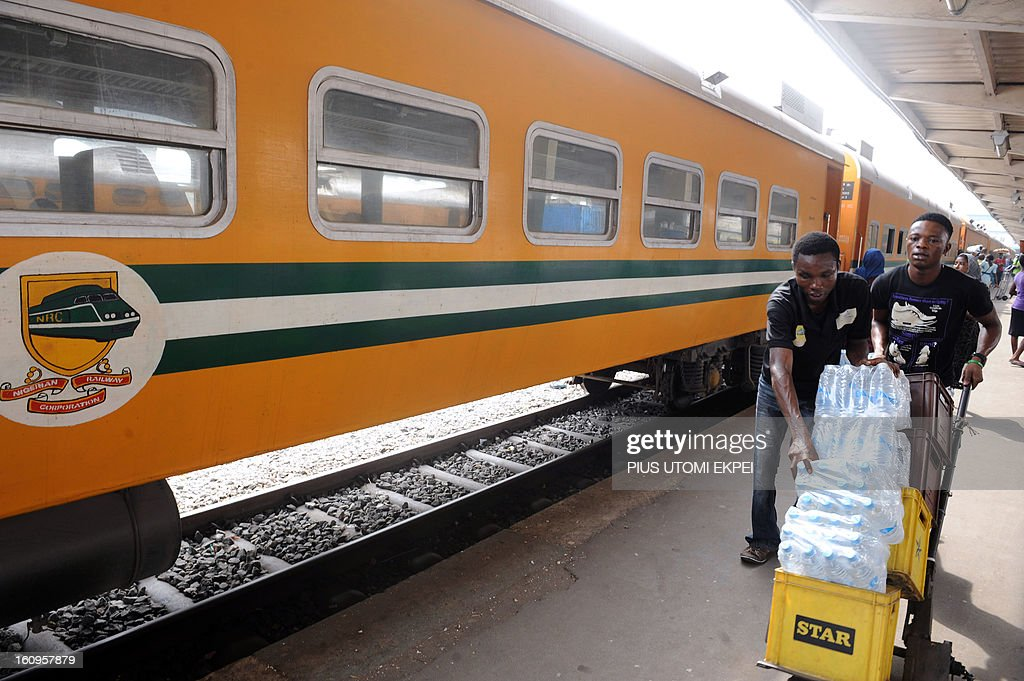 Passengers carry bottles of water on a trolley to the train at the Lagos Terminus on February 8, 2013. The rejuvenated Nigerian Railway Corporation has commenced operation of mass transit on the Lagos-Kano route, Nigeria's major commercial cities. The state-owned corporation which went into bankruptcy during the last 20 years due to lack of maintenance of infrastructure and high numbers of employees also began haulage of petroleum products from Lagos to the north of the country. Earlier last year, the Railway Corporation had acquired 20 pressurised tank wagons as it prepared to commence the fuel haulage. The 20 wagons have the capacity to lift 900,000 litres of petroleum products, the equivalent of 27 road tankers.