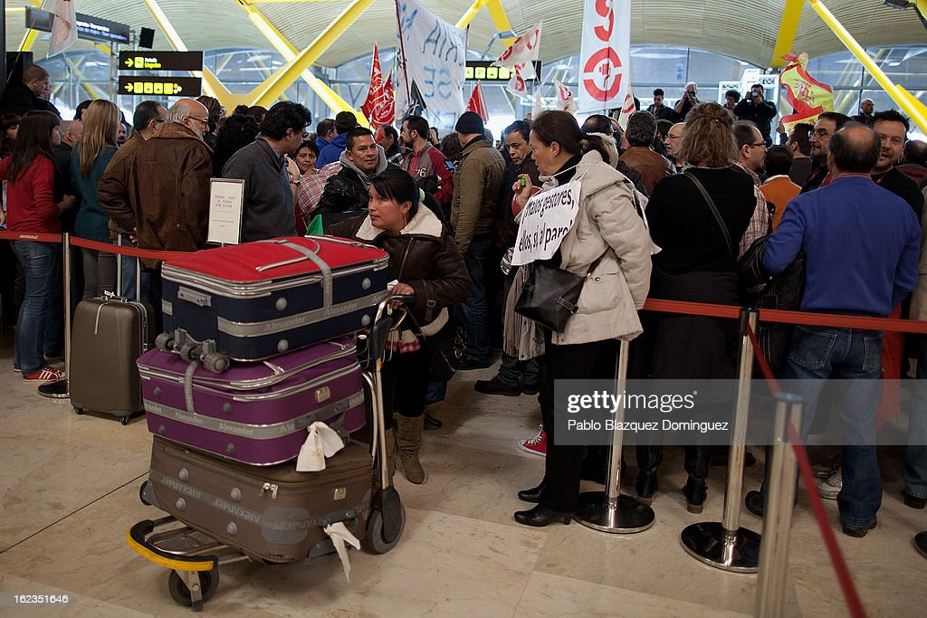 Passengers carry their lugage through a demonstration of Spanish Airline Iberia staff against job cuts at Barajas Airport on February 22, 2013 in Madrid, Spain. Today is the last of a five day strike held by Iberia cabin crew, maintenance workers and ground staff in response to the planned loss of 3,800 jobs. The strike has resulted in the airline having to cancel 400 flights this week with unions planning more five day strikes in the following weeks.