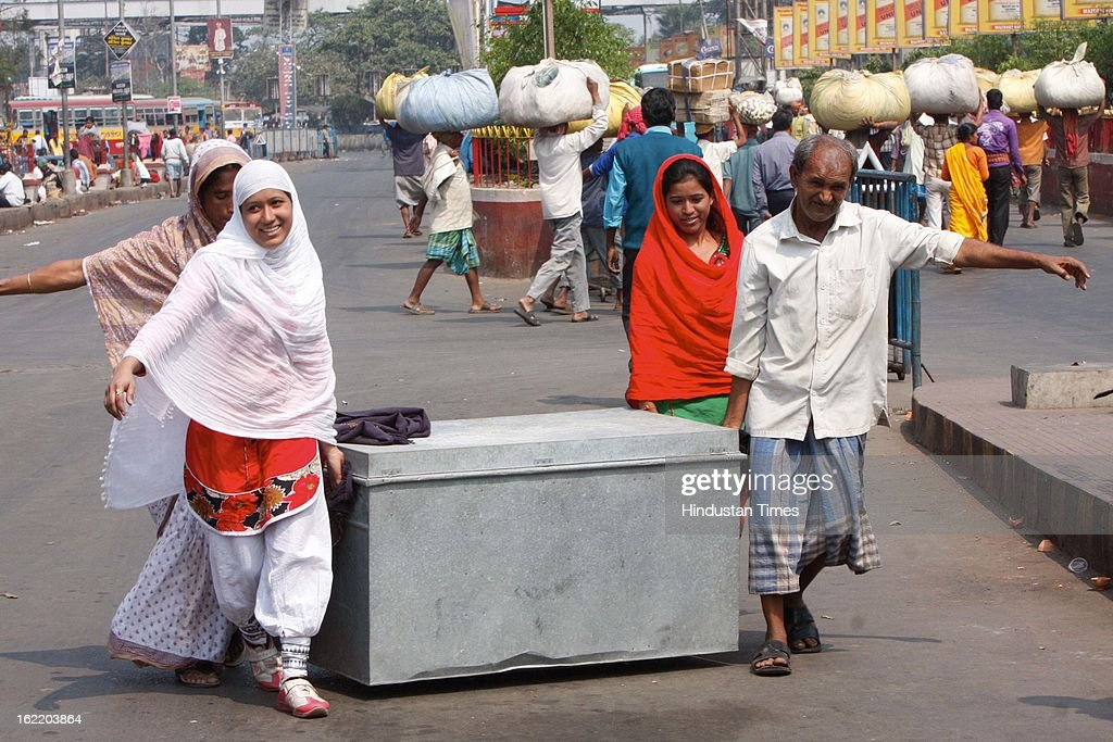 Passengers carry their luggage themselves as they didn't find any transportation at Howrah railway station during 48 hours nationwide strike called by 11 national trade unions crippled the life of city on February 20, 2013 in Kolkata, India. Despite state government warning the life in many parts of state was disrupted due to strike.