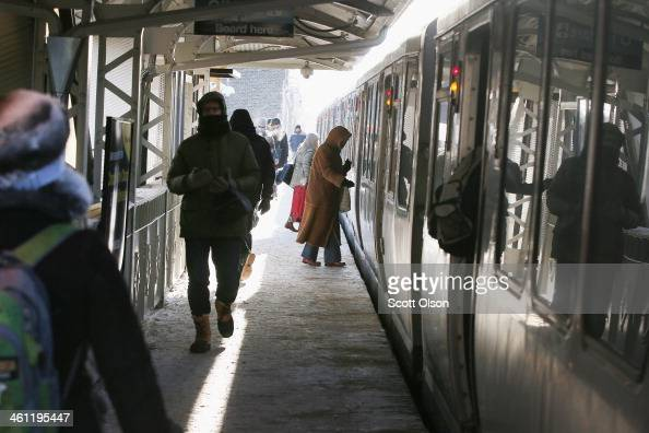 Passengers catch an 'L' train after waiting in below zero temperatures on January 7 2014 in Chicago Illinois Many trains were delayed on the system...