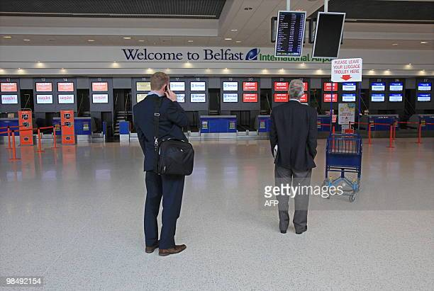 Passengers check an airline information board for cancelled flights at Belfast International airport in Northern Ireland on April 16 2010 Thousands...