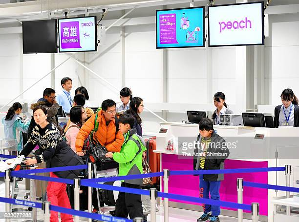 Passengers check in at the new terminal for low cost carriers at Kansai International Airport on January 28 2017 in Izumisano Osaka Japan