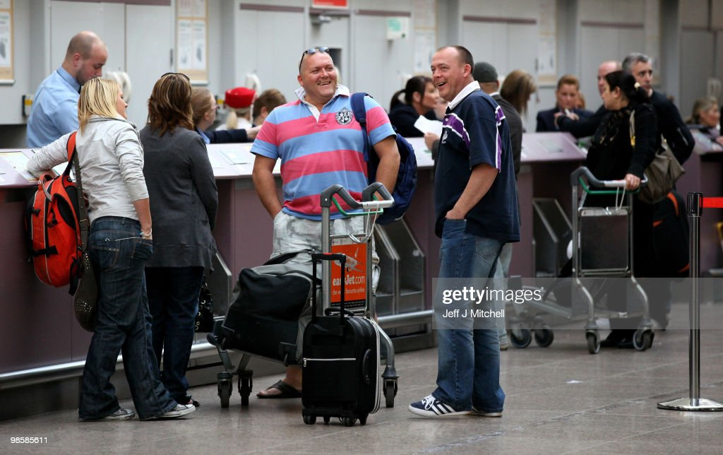 Passengers check in for flights after the airspace was shut down for six days due to volcanic ash on April 21, 2010 in Glasgow, Scotland. UK airports reopened on Tuesday night when safety test showed aircraft engines were able to cope in low density ash.