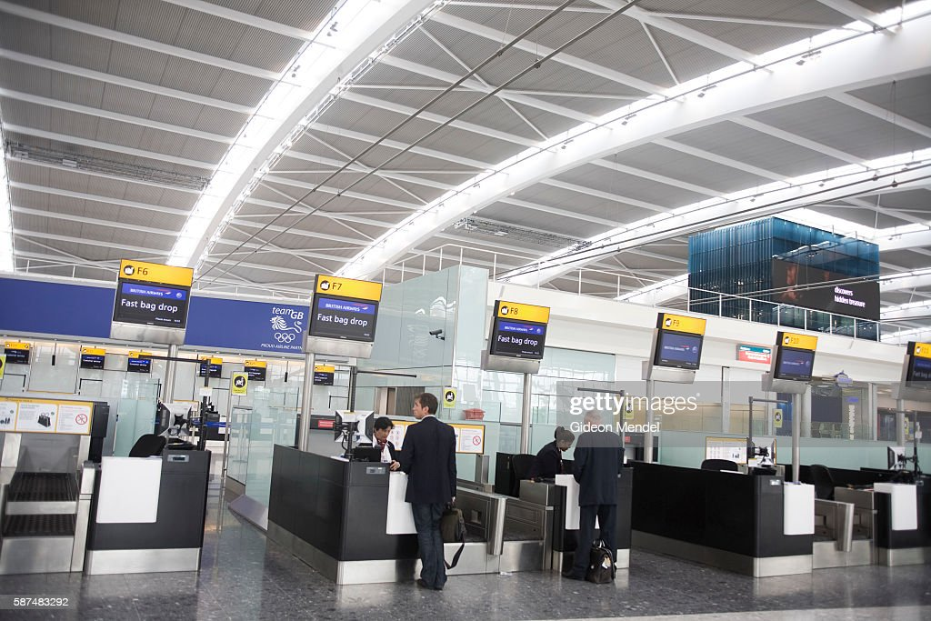 Passengers check in for their flights at the new Heathrow Terminal 5 building This checkin hall has architecturally distinctive white steel truss...