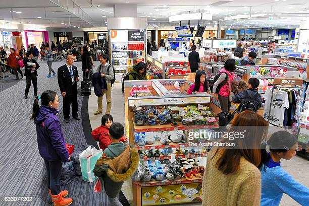 Passengers check souvenirs at duty free shops at the new terminal for low cost carriers at Kansai International Airport on January 28 2017 in...