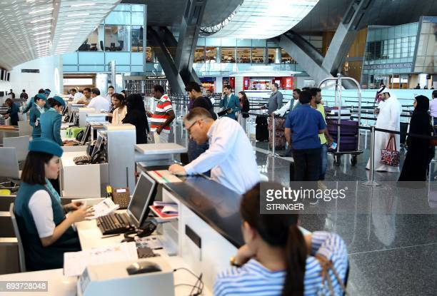 Passengers checkin at the Hamad International Airport in Doha on June 7 2017 A ban on Qatari flights imposed by Saudi Arabia and its allies took...