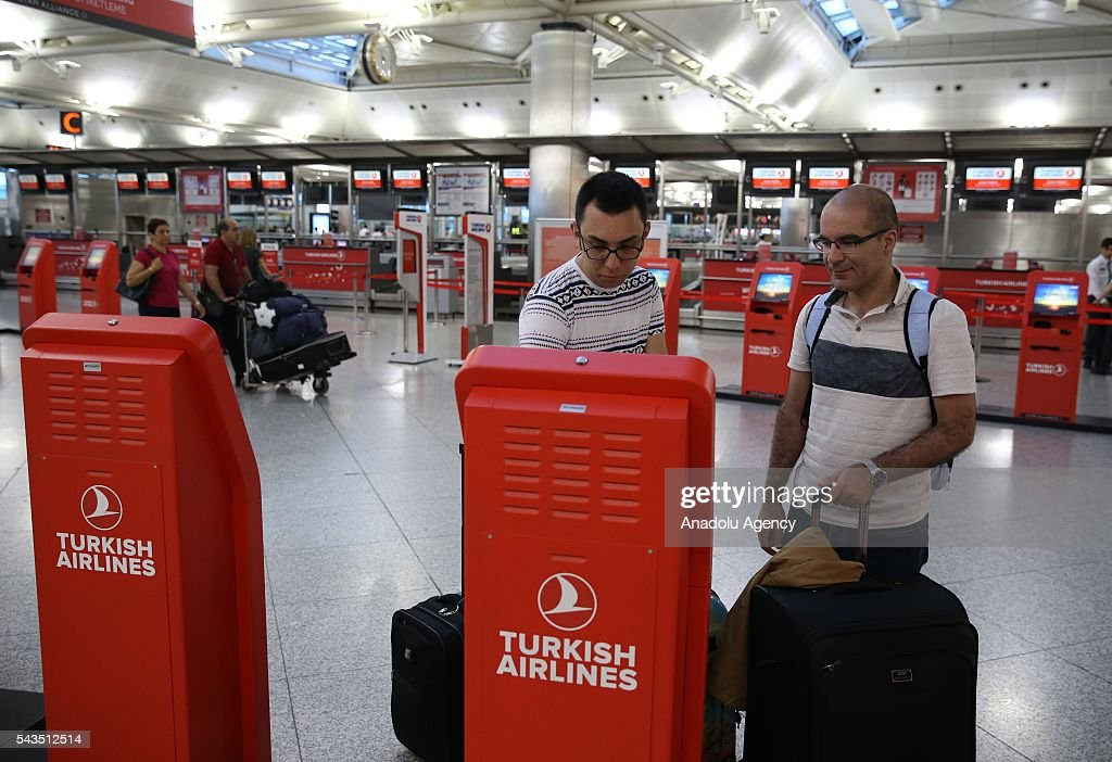 Passengers check-in for their flights at the Ataturk International Airport after the air traffic returned to normal following yesterday's terror attack in Istanbul, Turkey on June 29, 2016. At least 36 victims and three suicide bombers were killed while scores of others were injured in a terror attack on Istanbuls Ataturk International Airport.
