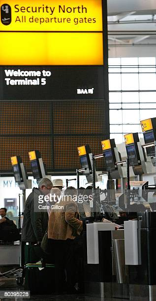 Passengers checkin in the departures area of Terminal 5 on March 27 2008 in London England Terminal 5 opens to the public for its first day of...
