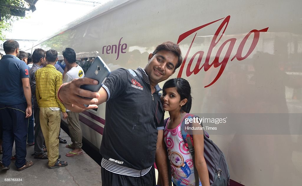 Passengers clicking selfie with Spanish train Talgo at Bareily railway station during its first trial run between Bareilly and Moradabad on May 29, 2016 in Bareilly, India. The trial of Spanish train Talgo, the lighter and faster vehicle with speed up to 115 km per hour, was conducted between Bareilly and Moradabad in Uttar Pradesh as part of the Railways' strategy to increase the speed of trains. Nine Talgo coaches were hauled by a 4,500 HP diesel engine on the 90-km line for the first trial run.