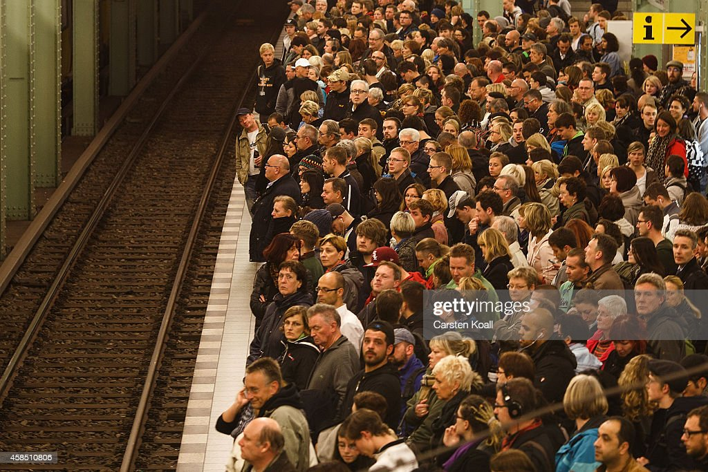 Passengers crowd the platform as they wait for the subway train retracted U5 line at the station Alexanderplatz during a four-day strike by the GDL train drivers labor union on November 6, 2014 in Berlin, Germany. The current strike, which affects passenger travel nationwide from today through Sunday, is the longest in the history of German state rail carrier Deutsche Bahn, which is in an increasingly bitter dispute over wages and working hours with the GDL.