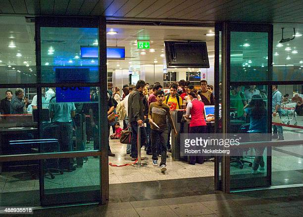 Passengers departing on a Turkish Airways flight to Kabul Afghanistan August 29 2015 have their boarding passes and passports checked at the Istanbul...