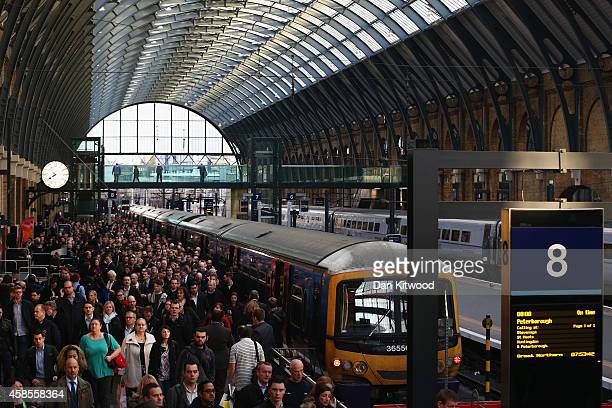 Passengers disembark a train at King's Cross station on November 7 2014 in London England