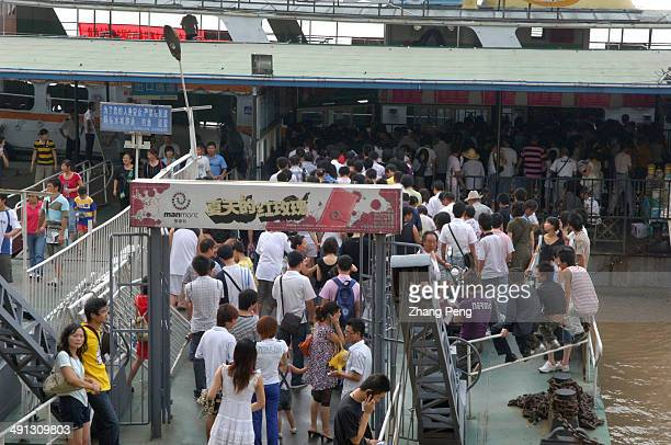 Passengers disembark and board ferries that ply across the Yangtze River The ferries are important to the citizens of Wuhan who need to commute to...