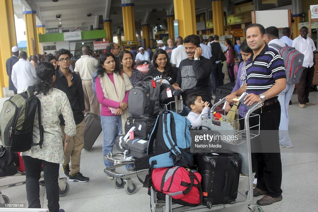 (Not for sale to The Star (Kenya), Capital FM, The People, Citizen TV, Kenya Broadcasting Corporation) Passengers disembark at Moi International Airport on August 07, 2013 in Nairobi, Kenya. Passengers were unable to leave after JKIA was closed indefinitely after fire gutted part of the international arrivals lobby.