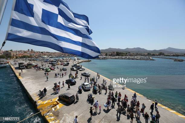 Passengers disembark from a ferry on to the island of Aegina on June 16 2012 in Aegina Greece The Greek electorate are due to go to the polls...