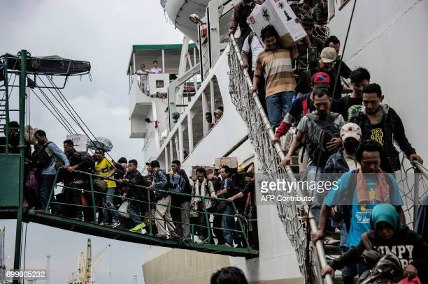 TOPSHOT Passengers disembark from a ship at Surabaya seaport in East Java province on June 22 as part of Indonesia's mass exodus to their respective...