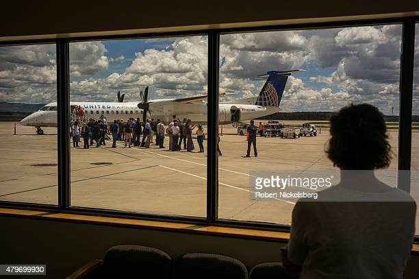 Passengers disembark from a United Airlines Express turboprop plane May 26 2015 in Durango Colorado