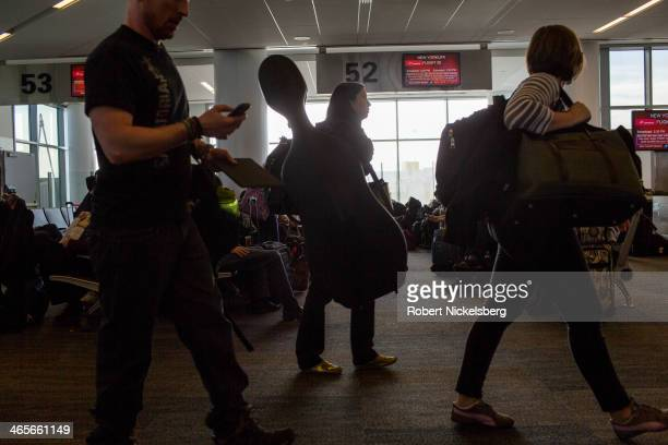 Passengers disembark from a Virgin America flight January 12 2014 in San Francisco California