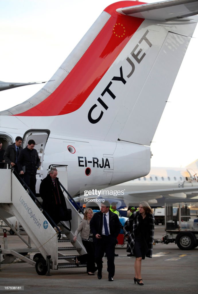 Passengers disembark from an Avro RJ85 aircraft, operated by CityJet Ltd., after landing at City Airport in London, U.K., on Tuesday, Dec. 4, 2012. Air France-KLM Group's CityJet unit is studying options for a new investor, with a trade buyer a possibility given its strength at London City airport, Chief Executive Officer Christine Ourmieres said in an interview. Photographer: Chris Ratcliffe/Bloomberg via Getty Images