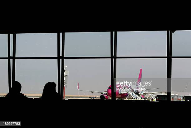 Passengers disembark from the low cost Hungarian Wizz Air at the newly opened AlMaktoum International airport the emirate's second airport in Dubai...