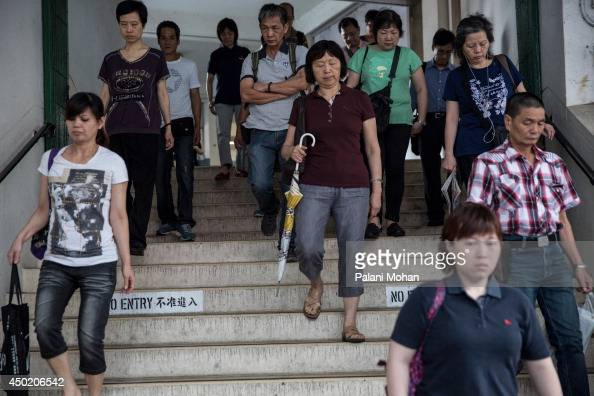 Passengers disembark from the Star Ferry at the Wanchai pier after an earlymorning crossing on June 6 2014 in Hong KongThe ferry which connects Hong...