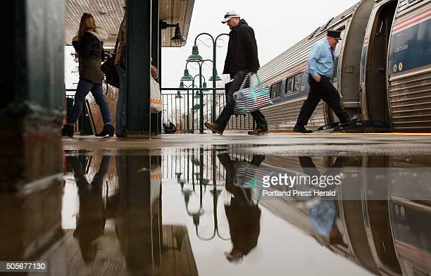 Passengers disembark the northbound train from Boston at the Saco Transportation Center a rainy Sunday in Saco Maine on January 10 2016